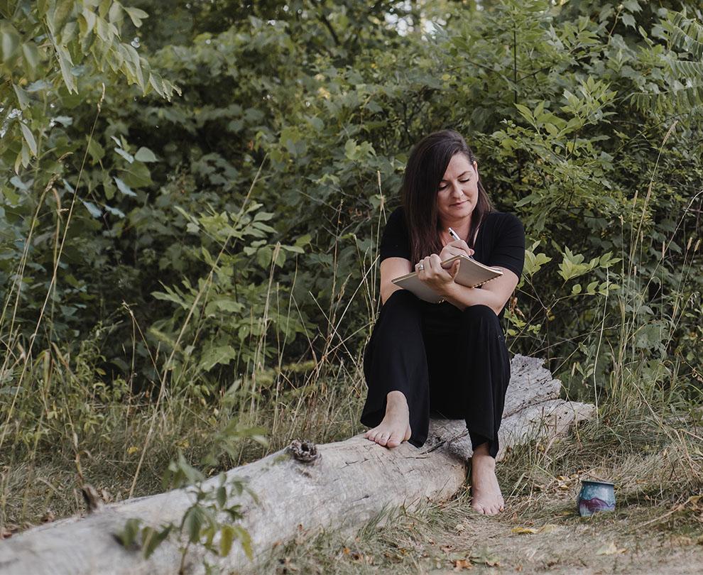 Jess journaling outdoors