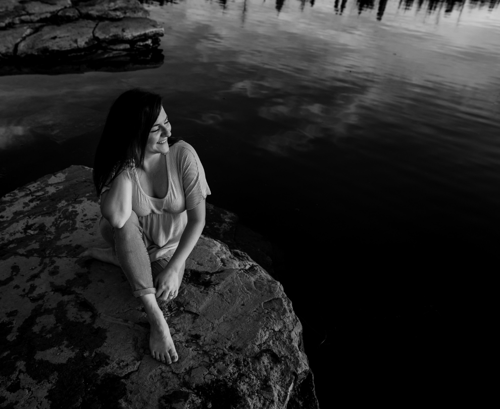 Jess self-reflecting on a rock